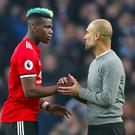 Could Paul Pogba (left) end up crossing Manchester to join City manager Pep Guardiola? (Nick Potts/PA Wire)