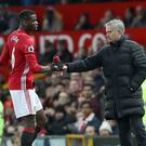 Manchester United's Paul Pogba (left) and Manager Jose Mourinho (right) shared a tense-looking training ground exchange on Wednesday (Martin Rickett/PA).