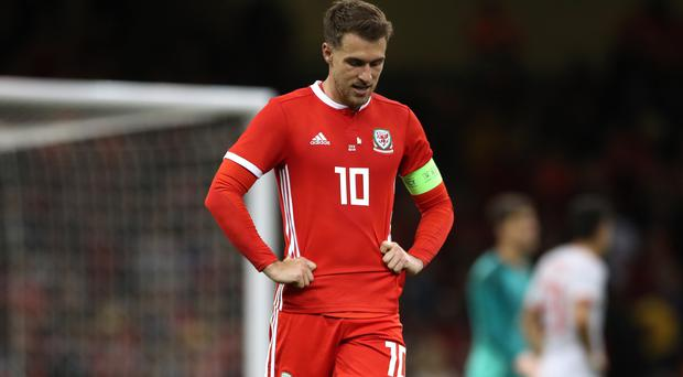 Aaron Ramsey captained Wales in the second half of their friendly defeat to Spain (Nick Potts/PA)