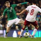 Republic of Ireland midfielder James McClean, left, wanted to play in Wales with a broken wrist (Niall Carson/PA)