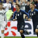 Antoine Griezmann was on target twice in the second half (Francois Mori/AP)