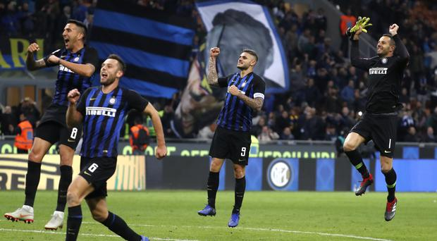 Mauro Icardi, centre right, celebrates his late winner for Inter in the Milan derby (Antonio Calanni/AP)