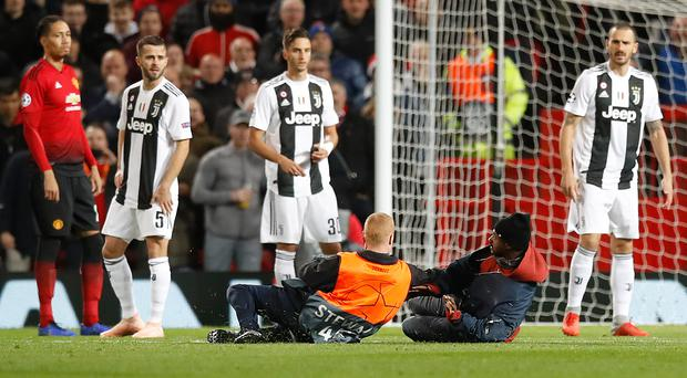 Manchester United are reviewing security following the incident against Juventus. (Martin Rickett/PA Wire)
