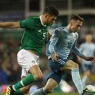 Republic of Ireland's John Egan (left) and Northern Ireland's Gavin Whyte battle for the ball during the International Friendly at The Aviva Stadium, Dublin.