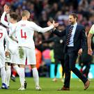 Gareth Southgate, centre right, and England celebrate victory over Croatia (Nick Potts/PA)