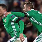 Corry Evans (left) scored Northern Ireland's equaliser, but Michael O'Neill's side suffered a last-gasp defeat to Austria (Brian Lawless/PA).