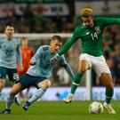Bore draw: Republic of Ireland's Callum Robinson (right) and Northern Ireland's Steven Davis compete in Irish stalemate