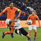 Virgil Van Dijk, left, scored a last-minute leveller for Holland against Germany (Martin Meissner/AP)