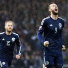 Steven Fletcher (right) celebrated his first Scotland hat-trick against Gibraltar (Kirk O'Rourke/PA)
