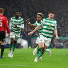 Two good: James Forrest celebrates his double for Celtic in the heavy victory against Kilmarnock