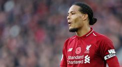 Virgil Van Dijk is confident Liverpool can cope with the dual challenge of the Premier League and Champions League (Barrington Coombes/PA)