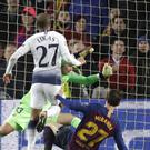 Lucas Moura scores the equaliser which sent Tottenham through to the Champions League knockout stages (Emilio Morenatti/AP).