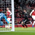 Arsenal's Alexandre Lacazette (right) scores his side's first goal of the game during the UEFA Europa League, group E match at Emirates Stadium, London.