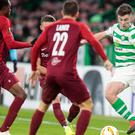 Kieran Tierney (right) in action (Graham Stuart/PA)