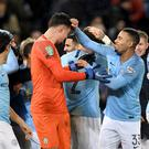 Manchester City players celebrate with goalkeeper Arijanet Muric (centre) as they win 3-1 in the penalty shoot out during the Carabao Cup, Quarter Final match at the King Power Stadium, Leicester.