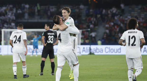 Real Madrid's defender Sergio Ramos and Real Madrid's midfielder Luka Modric celebrate after scoring during the Club World Cup final (Hassan Ammar/AP)