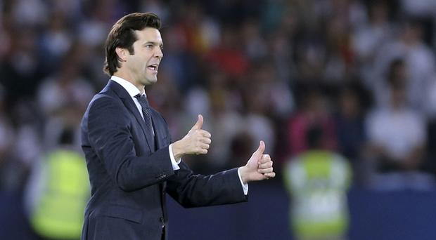 Real Madrid's coach Santiago Solari hailed the Club World Cup win (Kamran Jebreili/AP)