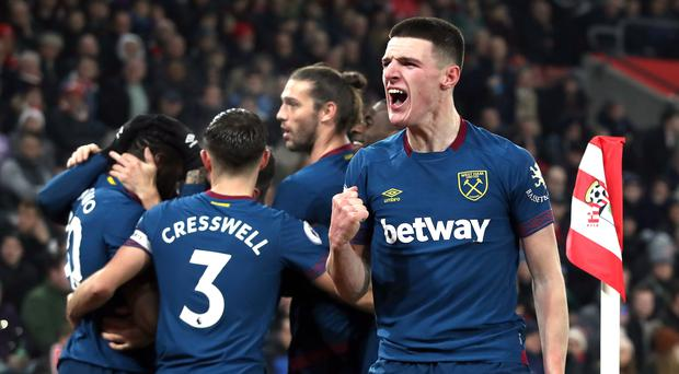 Declan Rice is celebrating a new contract (Andrew Matthews/PA)