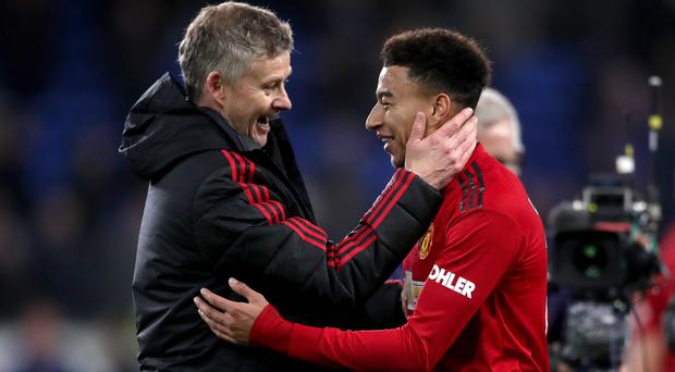 Jesse Lingard, right, wants to put on a show for Manchester United interim manager Ole Gunnar Solskjaer against Tottenham (Nick Potts/PA)