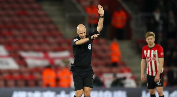 Referee Anthony Taylor signals for offside during the Emirates FA Cup third round replay match at St Mary's Stadium (Nick Potts/PA)