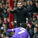 Stoke manager Nathan Jones faces Marcelo Bielsa's Leeds on Saturday (Nigel French/PA)