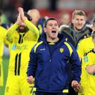 Nigel Clough and his Burton players celebrate after winning at Middlesbrough to reach the Carabao Cup semi-finals (Owen Humphreys/PA)