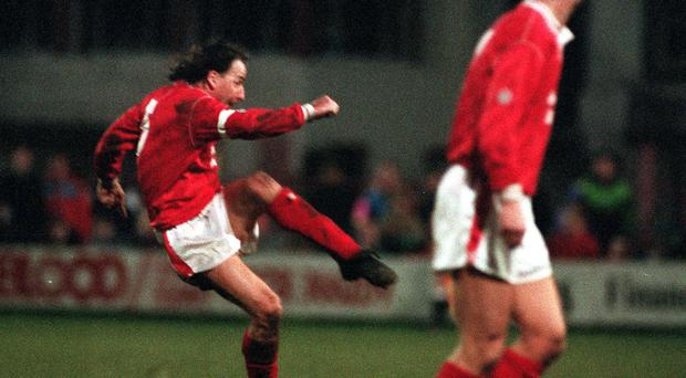 Former Wales star Mickey Thomas, scoring a famous FA Cup goal for Wrexham in their giant-killing victory over Arsenal in 1992, has been diagnosed with stomach cancer (Malcolm Croft/PA)
