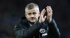 Manchester United caretaker manager Ole Gunnar Solskjaer says the team need to 'step up' following their loss to PSG (Martin Rickett/PA)