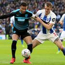 Brighton defender Dan Burn, right, enjoyed an FA Cup run with Wigan last season (Isabel Infantes/PA)