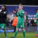 Watford's Will Hughes applauds the fans after the final whistle of the Emirates FA Cup fifth round match at Loftus Road, London.