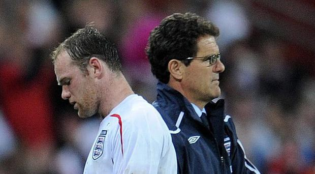 Fabio Capello, right, and Wayne Rooney have been critical of each other in the past (Owen Humphreys/PA)