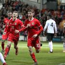 Wales' Ben Woodburn, centre, celebrates his late winner against Trinidad and Tobago (Nick Potts/PA)