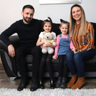 Family first: Scott Irvine at home in Greenisland with his wife Janine, daughters Brooke and Georgia