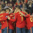 Spain's players celebrate Rodrigo's opener (Alberto Saiz/AP)