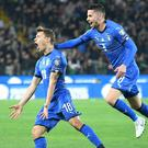 Nicolo Barella, left, celebrates his opening goal for Italy (Alberto Lancia/ANSA via AP)