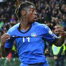 Moise Kean celebrates after scoring his side's second goal against Finland (Alberto Lancia/ANSA via AP)