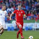Slovakia's Juraj Kucka (left) and Wales' Gareth Bale (right) battle for the ball during the UEFA Euro 2020 Qualifying, Group E match at the Cardiff City Stadium.