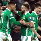 Josh Magennis (left) celebrates his late winner against Belarus (Brian Lawless/PA)