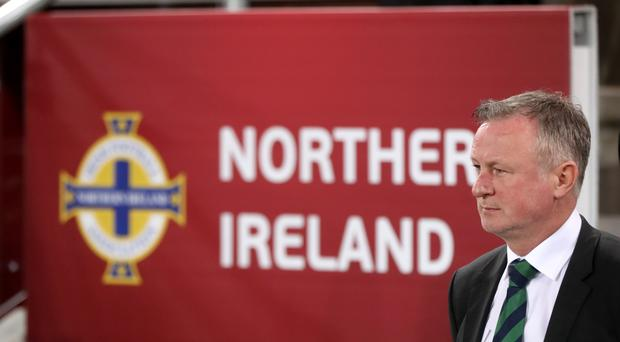 Michael O'Neill wants to win away (Niall Carson/PA)