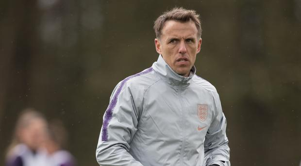 Phil Neville insists there are still places to be won in his World Cup squad (Aaron Chown/PA)