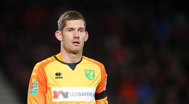Veteran goalkeeper Michael McGovern has put pen to paper on a new deal with Norwich. (Adam Davy/PA)