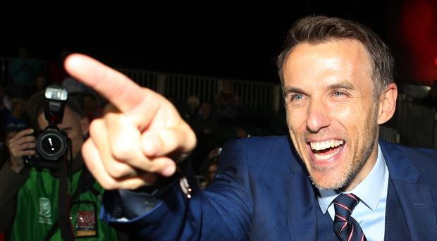 England Women manager Phil Neville celebrates victory after the FIFA Women's World Cup qualifying, group 1 match at Rodney Parade, Newport.