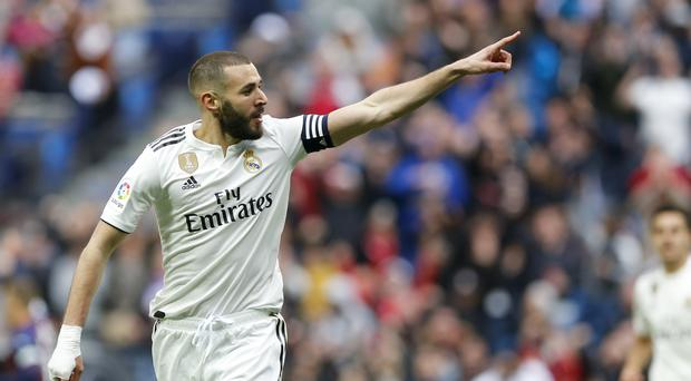 Karim Benzema scored twice for Real Madrid (Paul White/AP)