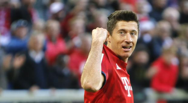 Bayern Munich's Robert Lewandowski celebrates after scoring his 200th Bundesliga goal in the 5-0 victory over Borussia Dortmund (Michael Probst/AP)