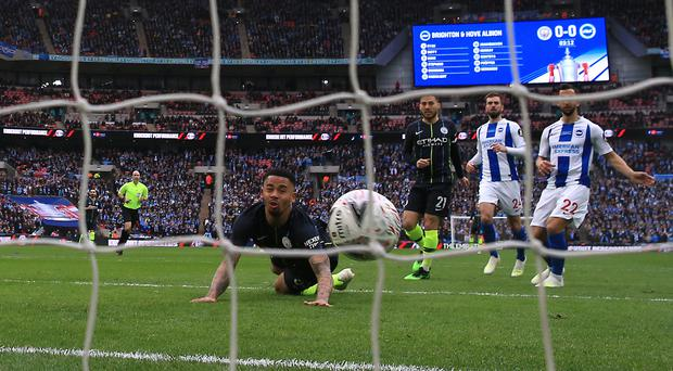 Gabriel Jesus, centre, scores City's winner in their FA Cup semi-final with Brighton at Wembley. (Nick Potts/PA)