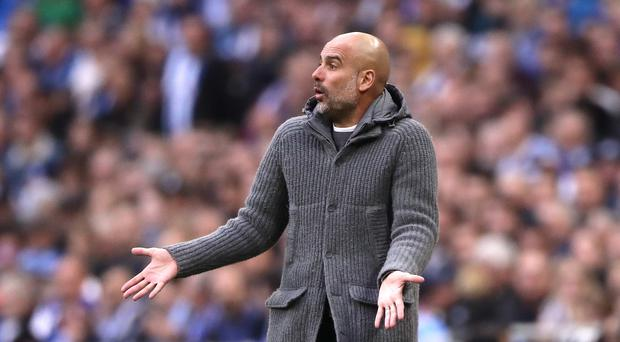 Pep Guardiola has praised his Manchester City players for still being in contention for the quadruple (John Walton/PA)