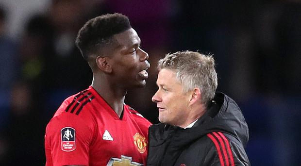 Ole Gunnar Solskjaer, right, is hoping Paul Pogba can stamp his class and authority on the game with Barcelona. (Adam Davy/PA)
