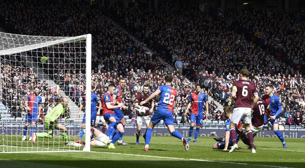 Uche Ikpeazu (second right, obscured) opens scoring as Hearts beat Inverness in Scottish Cup semi-final (Ian Rutherford/PA)