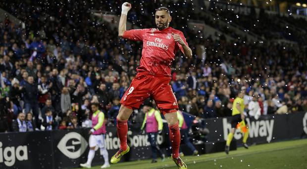 Karim Benzema celebrates his equaliser for Real Madrid early in the second half (Bernat Armangue/AP)