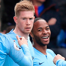 Key men: Raheem Sterling (right) celebrates with fellow Manchester City players Kevin De Bruyne and Leroy Sane
